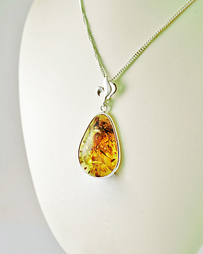 A Large Sparkling Pendant With Natural Baltic Amber In The Form Of Drops In Silver
