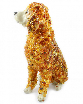 The Statue Of The Dog Breed Labrador With The Baltic Amber Type Pebble